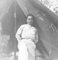 Dr. Richard Kainuma in front of his tent at Camp McCoy, Wisconsin, 1942 [Courtesy of  Bob Kainuma]